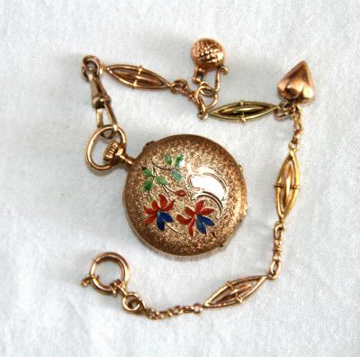 Золотые часы Qualite Boutte трехкрышечные